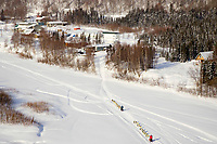 Aerial of Norwegian couple Tove Sorenson & Tore Albrightsen arriving @ Takotna Chkpt 2006 Iditarod