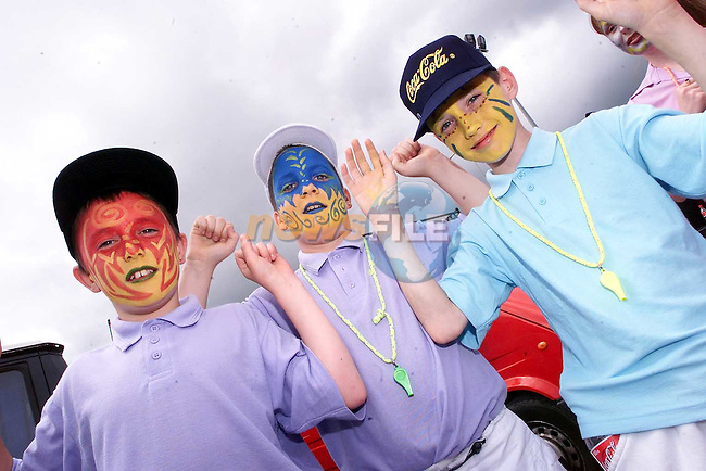 Mark Kelly, Martin Walsh and Phillip Walsh from Rathmullen at the Samba parade on Sunday..Picture Paul Mohan Newsfile