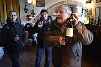 Michael McCollum.3/16/13.World famous winemaker Adamo displays a bottle, in Contucci winery, Montepulciano Italy. Wine enthusiasts Anita Binns-Moore and her boyfriend Alessio Melchiorri enjoy a glass of this very special wine in the late afternoon..