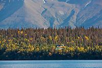 Float plane lands on Naknek lake, Katmai National Park, Alaska.
