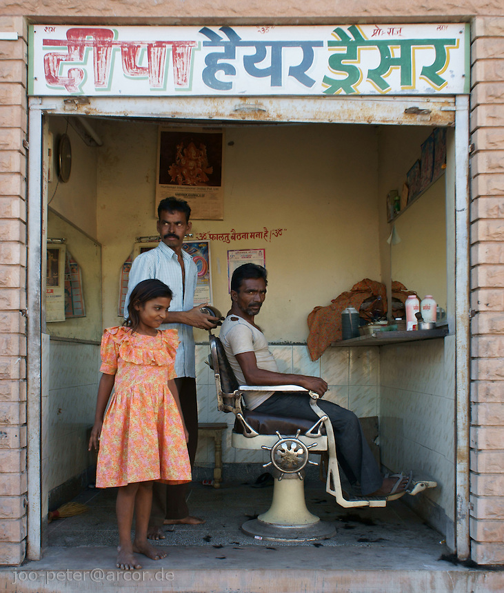 barber shop in the streets of Jodhpur,  Rajastan, India