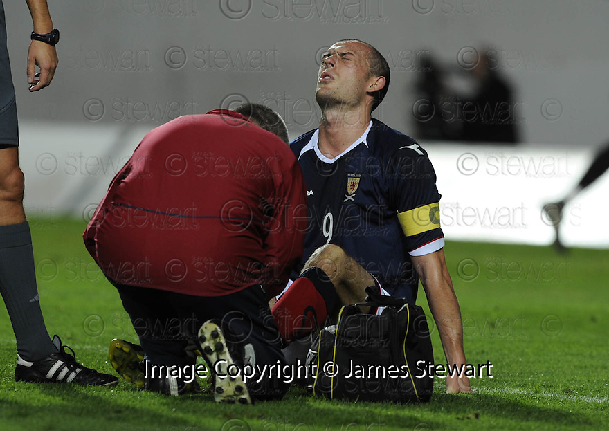 04/09/2008  Copyright Pic: James Stewart.File Name : sct_jspa10_scotland_v_slovenia.STEVEN FLETCHER RECEIVES TREATMENT AFTER BEING CAUGHT LATE BY ROK ELSNER.James Stewart Photo Agency 19 Carronlea Drive, Falkirk. FK2 8DN      Vat Reg No. 607 6932 25.James Stewart Photo Agency 19 Carronlea Drive, Falkirk. FK2 8DN      Vat Reg No. 607 6932 25.Studio      : +44 (0)1324 611191 .Mobile      : +44 (0)7721 416997.E-mail  :  jim@jspa.co.uk.If you require further information then contact Jim Stewart on any of the numbers above........