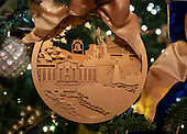 """The 2018 White House Christmas decorations, with the theme """"American Treasures"""" which were personally selected by first lady Melania Trump, are previewed for the press in Washington, DC on Monday, November 26, 2018.  This is a close-up of an ornament on one of the trees in the East Room showing the Northeast United States.  Visible are impressions of the White House, Statue of Liberty and the Liberty Bell    <br /> Credit: Ron Sachs / CNP"""
