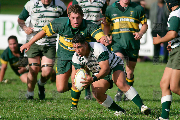 S. Lea gathers the ball as B. Crisp prepares to tackle him. Counties Manukau Premier Club Rugby, Pukekohe v Manurewa  played at the Colin Lawrie field, on the 17th of April 2006. Manurewa won 20 - 18.