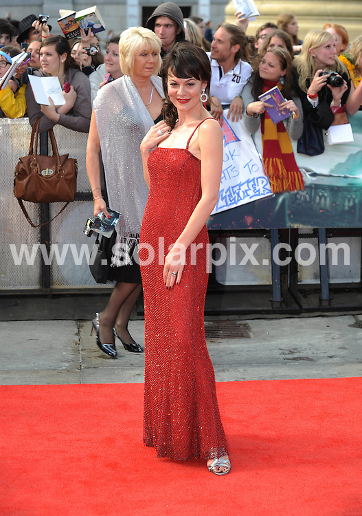 **ALL ROUND PICTURES FROM SOLARPIX.COM**                                             **WORLDWIDE SYNDICATION RIGHTS**                                                                                  Caption:  arrivals at the World Premiere of Harry Potter and The Deathly Hallows - Part 2, Trafalgar Square, London, UK. 7 July 2011                                                                             This pic: Helen McCrory                                                                                          JOB REF: 13679 LNJ       DATE: 07_07_2011                                                           **MUST CREDIT SOLARPIX.COM OR DOUBLE FEE WILL BE CHARGED**                                                                      **MUST AGREE FEE BEFORE ONLINE USAGE**                               **CALL US ON: +34 952 811 768 or LOW RATE FROM UK 0844 617 7637**