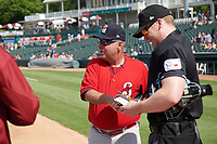 Springfield Cardinals manager Joe Kruzel (13) during the lineup exchange with umpire Andy Stukel before a Texas League game against the Frisco RoughRiders on May 5, 2019 at Dr Pepper Ballpark in Frisco, Texas.  (Mike Augustin/Four Seam Images)