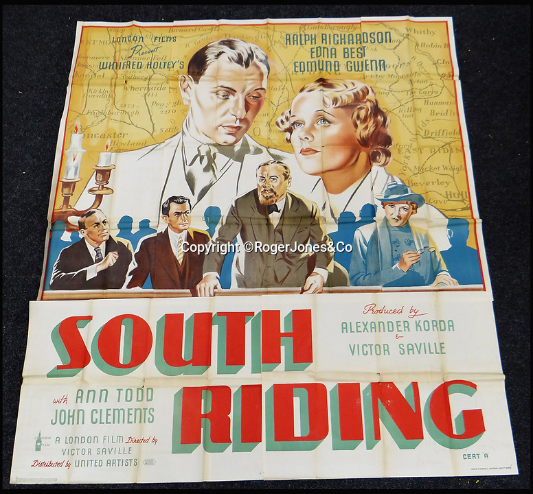 BNPS.co.uk (01202 558833)<br /> Pic: RogerJones&Co/BNPS<br /> <br /> South Riding, 1938.<br /> <br /> A rare collection of 1930s and 40s cinema posters discovered by two builders after they were used as carpet underlay have sold for a whopping £75,000.<br /> <br /> More than half the total was made on a single poster, John Wayne's breakthrough film Stagecoach (1939), which sold for £31,000.<br /> <br /> The classic Hollywood movie posters, which were in near pristine condition, are from the halcyon days of cinema and included well known names such as Alfred Hitchcock, Sir Laurence Olivie and Boris Karloff.<br /> <br /> Before the sale auctioneers Rogers Jones & Co said it was difficult to predict what the posters would sell for as no comparisons had ever come to market but the collection of about 120 posters was expected to fetch several thousands.<br /> <br /> Two builders made the discovery in 1985 when they were renovating the home of a local cinema owner who had died in Penarth, south Wales.