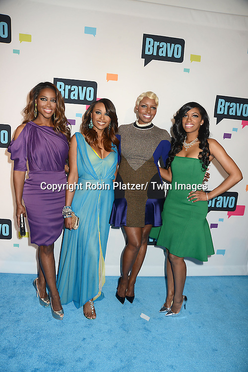 "cast of "" The Real Housewives of Atlanta"" , Kenya Moore, Cynthia Bailey, NeNe Leakes and Porsha Stewart arrive at the Bravo 2013  Upfront on April 3, 2013 at Pillars 37 Studio in New York City."