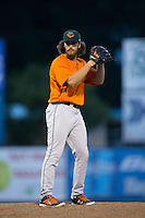 Augusta GreenJackets relief pitcher Caleb Smith (33) looks to his catcher for the sign against the Kannapolis Intimidators at Intimidators Stadium on May 30, 2016 in Kannapolis, North Carolina.  The GreenJackets defeated the Intimidators 5-3.  (Brian Westerholt/Four Seam Images)