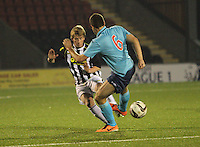 Jon Scullion and Stephen Husband (6) tackle in the St Mirren v Dunfermline Athletic Scottish Professional Football League Under 20 match played at the Excelsior Stadium, Airdrie on 11.12.13.