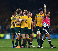 Referee Romain Poite awards Australia a penalty. Rugby World Cup Pool A match between England and Australia on October 3, 2015 at Twickenham Stadium in London, England. Photo by: Patrick Khachfe / Onside Images