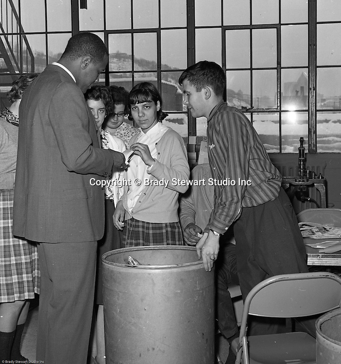 Pittsburgh PA:  Willie Stargell getting a tour of the Goodwill Industries facility along with signing autographs - 1966.  Willie and a many other Pittsburgh Pirates were very involved in the community supporting charitable causes.