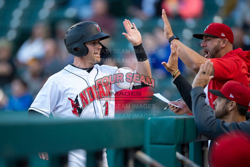 Indianapolis Indians Jake Elmore (13) is congratulated by manager Brian Esposito (5) and hitting coach Ryan Long (29) after scoring a run during an International League game against the Columbus Clippers on April 29, 2019 at Victory Field in Indianapolis, Indiana. Indianapolis defeated Columbus 5-3. (Zachary Lucy/Four Seam Images)