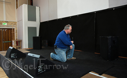 11 APR 2015 - STOWMARKET, GBR - John Peel Centre for Creative Arts sound engineer Phillip Radley prepares the sound system before the Larkin Poe gig in Stowmarket, Great Britain (PHOTO COPYRIGHT © 2015 NIGEL FARROW, ALL RIGHTS RESERVED)