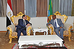 Egyptian President Abdel Fattah al-Sisi is welcomed by Ethiopian Prime Minister Hailemariam Desalegn upon arriving at the Bole International Airport in Ethiopia's capital Addis Ababa, March 23, 2015. Leaders from Egypt, Ethiopia and Sudan signed a cooperation deal on Monday over a giant Ethiopian hydroelectric dam on a tributary of the river Nile, in a bid to ease tensions over regional water supplies. Photo by Egyptian presidency