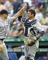 Seattle Mariners C Jamie Burke celebrates the win with P Jarrod Washburn against the Texas Rangers on May 14th, 2008 at Texas Rangers Ball Park. Photo by Andrew Woolley / Four Seam Images.
