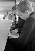 Boys hiding stuff from the teacher, Whitworth Comprehensive School, Whitworth, Lancashire.  1970.