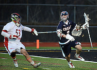 HORSHAM, PA - MARCH 31: Central Bucks East goaltender Marc Poust #53 chases Hatboro Horsham's Owen Winters #2 during the second half of a lacrosse game at Hatboro Horsham High School March 31, 2014 in Horsham, Pennsylvania. (Photo by William Thomas Cain/Cain Images)