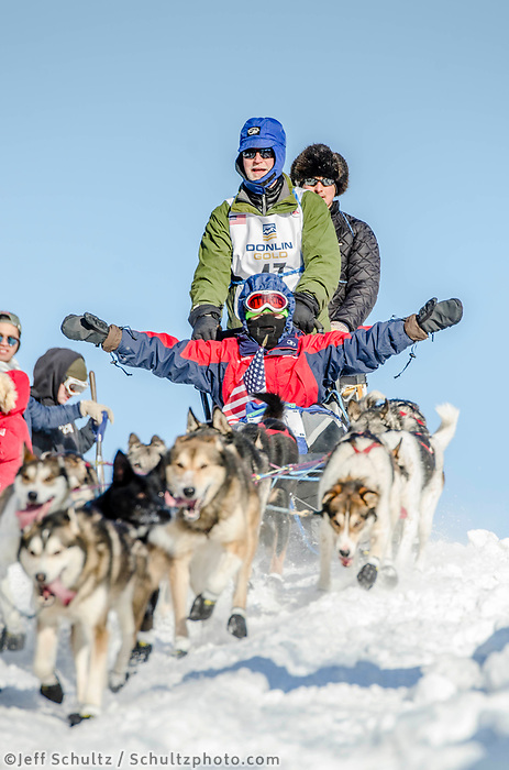 Paul Hansen and team run past spectators and down the Cordova Street hill with an Iditarider in the basket and a handler during the Anchorage, Alaska ceremonial start on Saturday March 4th during the 2017 Iditarod race. Photo ©2017 by Daniel Lent/SchultzPhoto.com