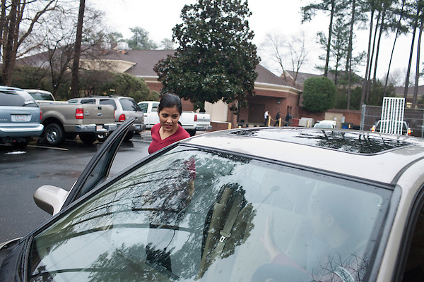 December 16, 2010. Raleigh, NC.. Renuka Adhikari, the wife of TP Mishra, is dropped off at her second job. Nearly everyday, he picks her up from one job and then drops her at the next. . TP Mishra, a refugee from Bhutan, has recently relocated from the Bronx to Raleigh, where he lives in an suburban apartment  with his wife, as well as another Bhutanese couple.