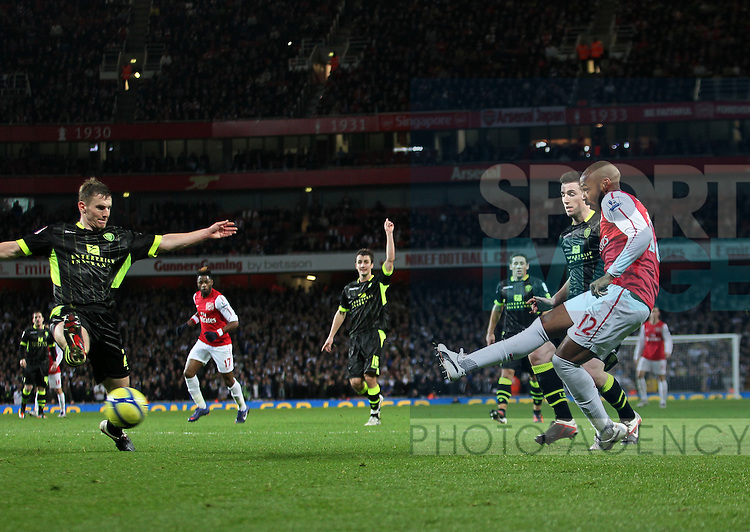 Arsenals Thierry Henry scoring his sides opening goal, his first game and goal for Arsenal since his return as a player..Arsenal v Leeds in the the FA Cup with Budweiser, 3rd round at the Emirates, London. 9th January 2012.--------------------.Sportimage +44 7980659747.picturedesk@sportimage.co.uk.http://www.sportimage.co.uk/.Editorial use only. Maximum 45 images during a match. No video emulation or promotion as 'live'. No use in games, competitions, merchandise, betting or single club/player services. No use with unofficial audio, video, data, fixtures or club/league logos.
