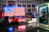NEW YORK, NY - April 13:  a picture of a nurse is seen on a stand at Times Square during a rainy day on April 13, 2020. in New York, United States. The global economy is facing the worst collapse since the WWII, while COVID-19  pandemic has now killed more than 22,000 people in the United States and at least 1,864,629 people died world wide. (Photo by Eduardo MunozAlvarez/VIEWpress)