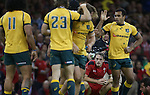 A dejected Cory Allen at the final whistle as the Australian players celebrate victory over Wales.<br /> Dove Men Series 2014<br /> Wales v Australia<br /> Millennium Stadium<br /> 08.11.14<br /> &copy;Steve Pope-SPORTINGWALES