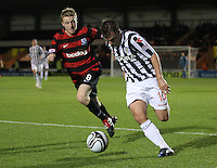 Paul McGowan chased by Robbie Crawford in the St Mirren v Ayr United Scottish Communities League Cup match played at St Mirren Park, Paisley on 29.8.12.