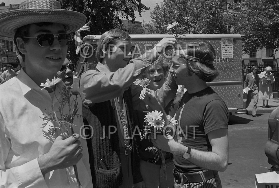 28 Jun 1970; Manhattan; New York City; New York State; USA. First Gay Parade was held in New York City. The begining of the parade men gave flowers to each others.