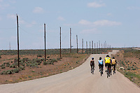 Riders on a lonely road side near east of Bluff, Utah, June 30, 2010. The Red Rock Canyons Tour, organized by Lizard Head Cycling Tours, wound through 400 miles of the desert southwest. The route traveled through canyons and national monuments in Colorado, Utah and Arizona, ending at Lake Powell. (Kevin Moloney for the New York Times)
