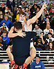Hunter Scutellaro of Massapequa leaps into the arms of his coach to celebrate his dramatic victory over Kevin DePalma at 120 pounds in the Nassau County Division I varsity wrestling finals at Hofstra University on Sunday, Feb. 12, 2017. Scutellaro scored a two-point takedown in the final second of the match to break a 4-4 tie and win by decision 6-4.