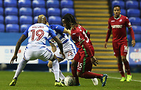 Renato Sanches of Swansea City is challenged by Leandro Bacuna of Reading during the Carabao Cup Third Round match between Reading and Swansea City at Madejski Stadium, Reading, England, UK. Tuesday 19 September 2017