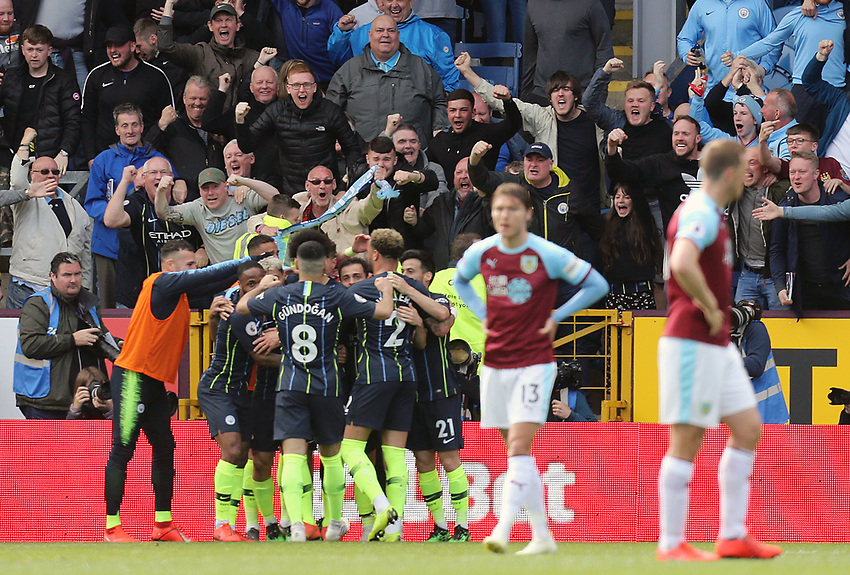 Manchester City celebrate in front of their fans as Burnley's Matthew Lowton failed to prevent a strike from  Sergio Aguero crossing the line for the opening goal<br /> <br /> Photographer Rich Linley/CameraSport<br /> <br /> The Premier League - Burnley v Manchester City - Sunday 28th April 2019 - Turf Moor - Burnley<br /> <br /> World Copyright © 2019 CameraSport. All rights reserved. 43 Linden Ave. Countesthorpe. Leicester. England. LE8 5PG - Tel: +44 (0) 116 277 4147 - admin@camerasport.com - www.camerasport.com