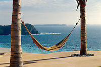 A simple hammock slung between two palm trees offers the best location for a siesta anywhere along the coast