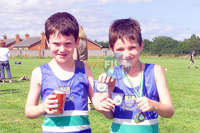 Brothers Conor and Niall reilly from Ardee with there medals after winning at teh Boyne A.C. meeting in Drogheda sponsored by Drogheda Concentrates..Photo Fran Caffrey/Newsfile.ie..This picture has been sent to you by:.Newsfile Ltd,.3 The View,.Millmount Abbey,.Drogheda,.Co Meath..Ireland..Tel: +353-41-9871240.Fax: +353-41-9871260.GSM: +353-86-2500958.ISDN: +353-41-9871010.IP: 193.120.102.198.www.newsfile.ie..email: pictures@newsfile.ie..This picture has been sent by Fran Caffrey.francaffrey@newsfile.ie