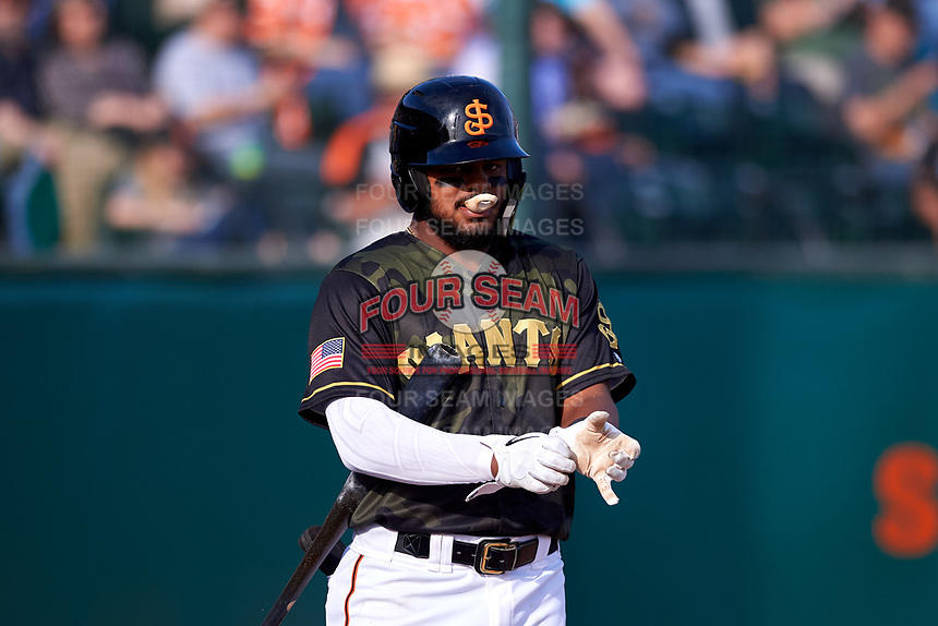 San Jose Giants center fielder Heliot Ramos (13) during a California League game against the Visalia Rawhide on April 13, 2019 at San Jose Municipal Stadium in San Jose, California. Visalia defeated San Jose 4-2. (Zachary Lucy/Four Seam Images)