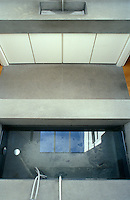 Seen from above, the bath, floor and wash basin in this minimal bathroom have all been constructed from matching grey concrete