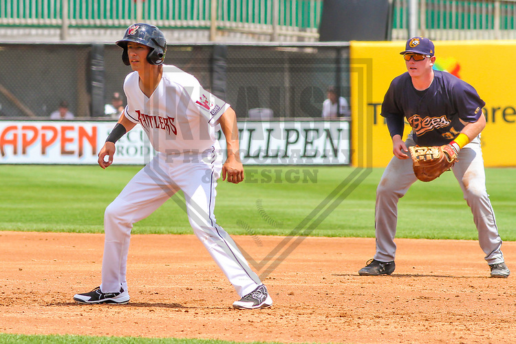 Wisconsin Timber Rattlers first baseman Ryan Aguilar (21) leads off first base as Burlington Bees first baseman Brennan Morgan (31) plays behind him during a Midwest League game on July 10, 2017 at Fox Cities Stadium in Appleton, Wisconsin.  Burlington defeated Wisconsin 6-3. (Brad Krause/Krause Sports Photography)