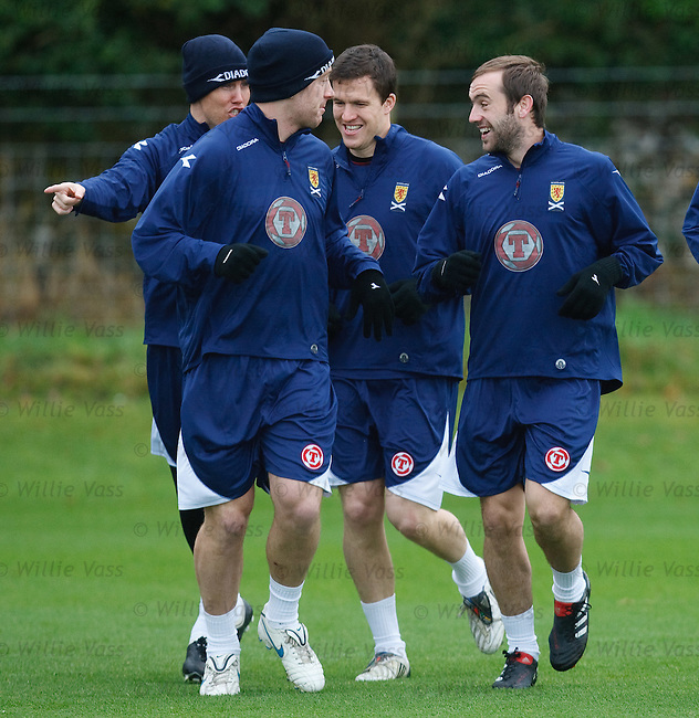 James McFadden laughs with Miller, Adam and Caldwell