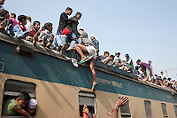 Muslim devotees climb on an over-crowded train as they return home after a three-day World Congregation of Muslims, or Biswa Ijtema, on the banks of the River Turag just outside  Dhaka, Bangladesh. Jan 11, 2015