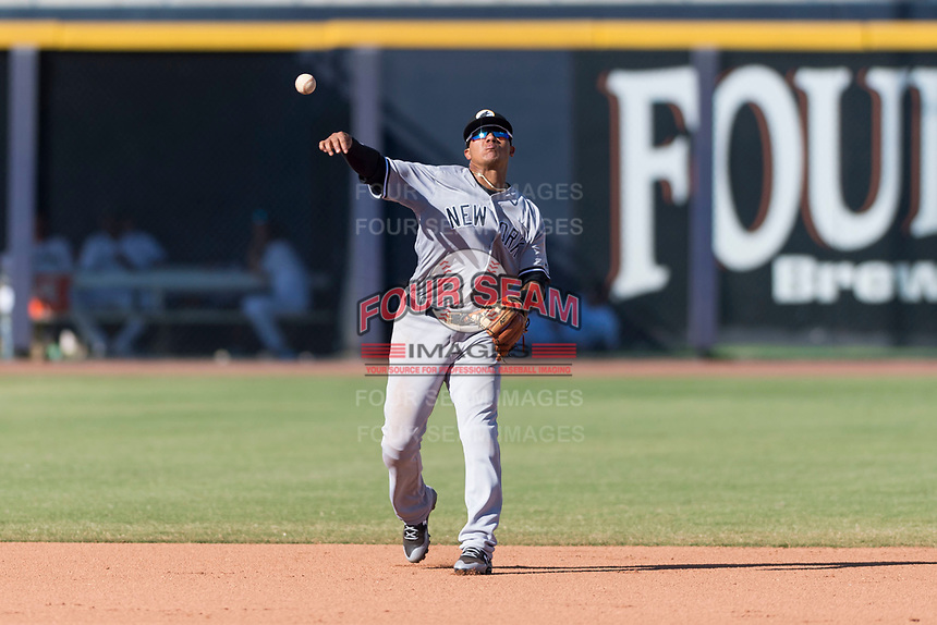 Glendale Desert Dogs shortstop Thairo Estrada (90), of the New York Yankees organization, throws to first base during an Arizona Fall League game against the Peoria Javelinas at Peoria Sports Complex on October 22, 2018 in Peoria, Arizona. Glendale defeated Peoria 6-2. (Zachary Lucy/Four Seam Images)