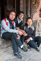 Nepal, Patan, Durbar Square.  Two Young Nepali Men, One Newari Woman.