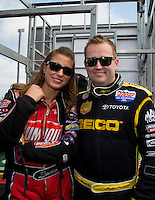 Apr 27, 2014; Baytown, TX, USA; NHRA top fuel dragster driver Leah Pritchett (left) poses with Richie Crampton during the Spring Nationals at Royal Purple Raceway. Mandatory Credit: Mark J. Rebilas-
