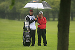Damien McGrane (IRL) and caddy John Hort shelter from the rain on the 1st hole during Day 1 of the BMW International Open at Golf Club Munchen Eichenried, Germany, 23rd June 2011 (Photo Eoin Clarke/www.golffile.ie)