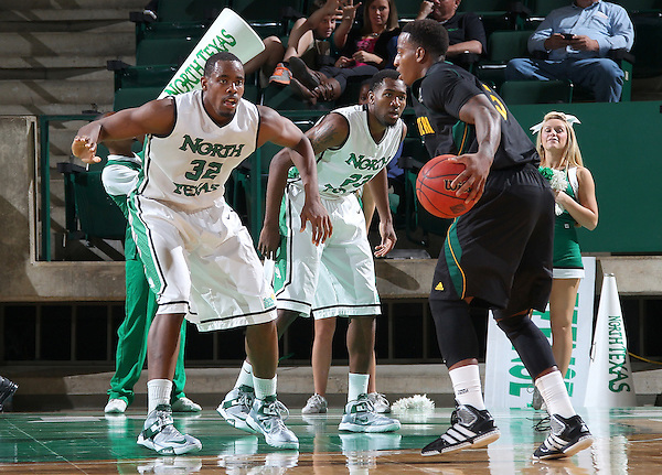 DENTON, TX - DECEMBER 16:  Roger Franklin #32 of the North Texas Mean Green guards Brandon Fortenberry #5 of the Southeastern Louisiana Lions at the UNT Coliseum on December 16, 2012 in Denton, Texas. (Photo by Rick Yeatts/Getty Images)