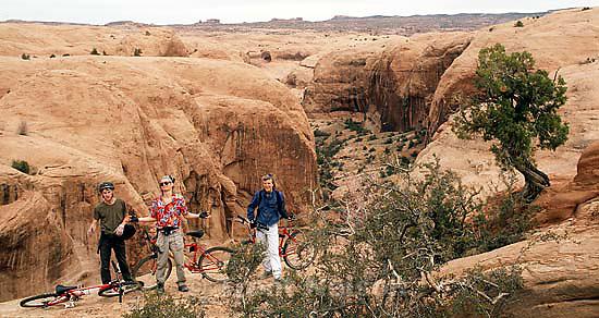 Trent Nelson, Alex Van Valin, Laura Nelson on the Slickrock Bike Trail.<br />