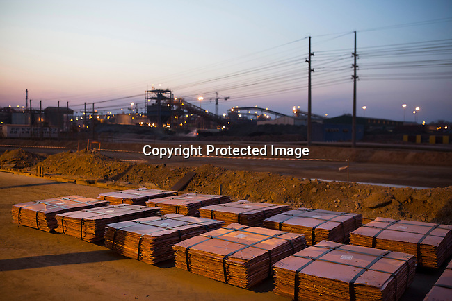 KOLWEZI, DRC- JULY 7: Batches of processed copper waits to be loaded on trucks at Mutanda Mining Sarl, owned (69%) by Glencore, an Anglo-Swiss multinational commodity trading and mining company on July 7, 2016 in Kolwezi, DRC. These copper sheets are ready for shipping by truck to ports such as Dar es Salaam, Tanzania or Durban, South Africa. The mine is mainly producing copper but also some cobalt. The mine employs about 3,500 people and its located in Luabala Province in Southern DRC. (Photo by Per-Anders Pettersson)