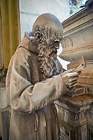 Pictures and image of a realistic style  stone sculpture of a priest, monumental tombs of the Staglieno Monumental Cemetery, Genoa, Italy