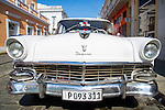CIENFUEGOS, CUBA - DECEMBER 29: A vintage car parked in Cienfuegos, Cuba on December 29, 2013.  Prior to 2011, Cuban citizens could only purchase pre-revolution vehicles.
