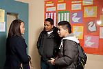 High school students talking in corridor.